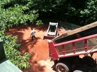 Dump truck unloading dirt