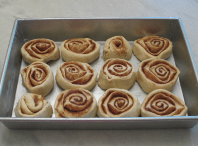 Cinnamon Roll dough rolled and cut