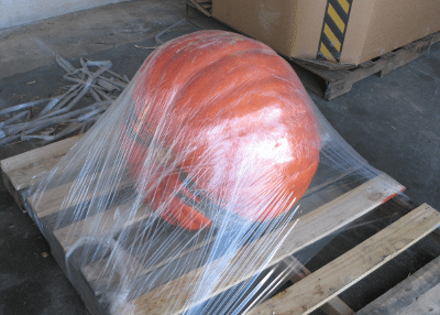 Shrinkwrapped giant pumpkin on pallet