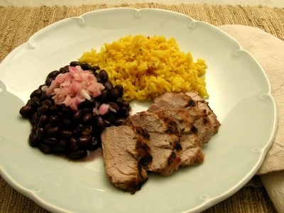 Mojo Criollo marinated pork, black beans, and yellow rice.