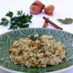 Israeli couscous with coconut milk, pine nuts, and parsley