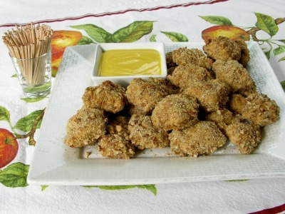 Homemade Baked Pecan Chicken Nuggets Bites with honey mustard dipping sauce