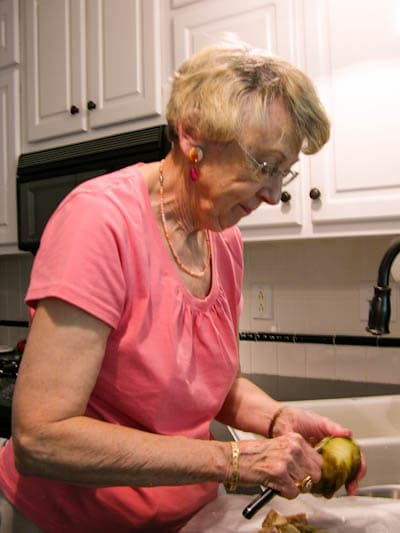Mom peeling potatoes for German Potato Salad