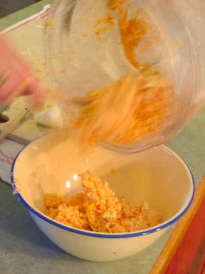 Putting the pimento cheese balls mixture into a bowl
