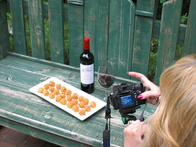Photo of taking a photo of pimento cheese balls on a bench