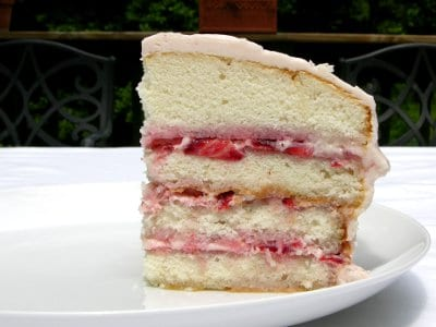 Cake made with fresh strawberries, jam, and cream cheese frosting