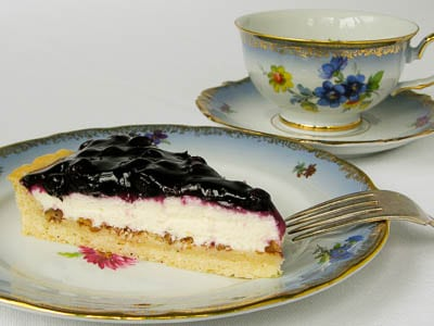 A slice of a blueberry cream cheese tart