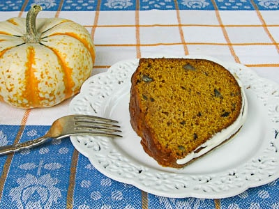 A slice of Pumpkin Pecan Bundt Cake with a cream cheese glaze