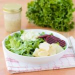 German-style salad with leaf lettuce, celeriac salad, beets, cucumber salad, and a light vinaigrette