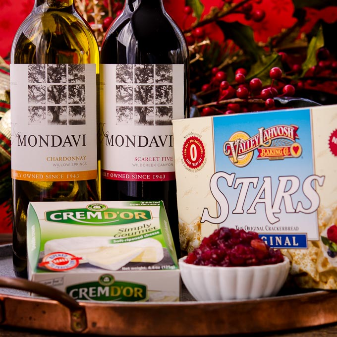 Get your party started with Apple Cranberry Chutney, CK Mondavi Wine, cheese, and crackers.