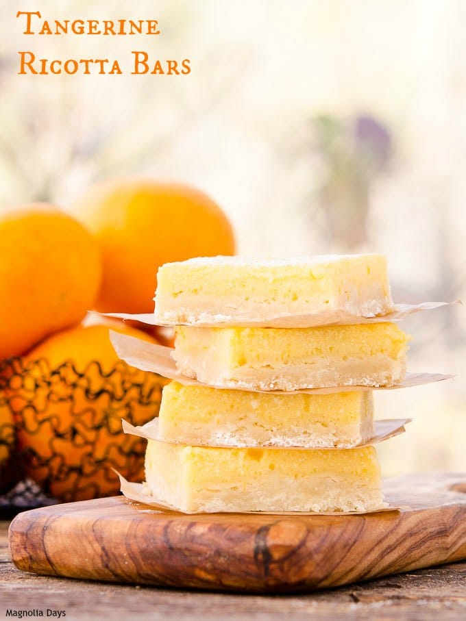 Tangerine Ricotta Bars have a light citrus flavor. The cheesecake-like filling on a buttery crust makes it a scrumptious treat for any occasion.