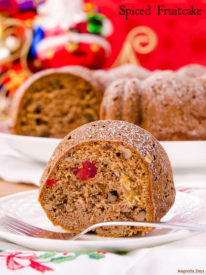 Spiced Fruitcake is a delightful combination of spice cake and traditional fruitcake. It has raisins, candied cherries, walnuts and warm spices.