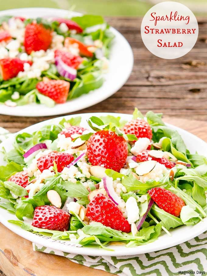Sparkling Strawberry Salad is a delightful mix of greens, couscous, fresh strawberries, almonds, feta cheese with sparkling almond dressing.