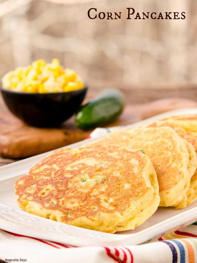 Savory Corn Pancakes are filled with corn kernels and jalapeño peppers. Serve them topped with chili, pulled pork BBQ, or simply butter.