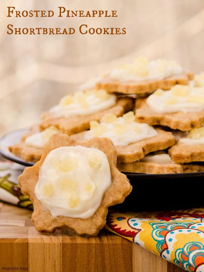 Enjoy a taste of the tropics with Frosted Pineapple Shortbread Cookies. They are crunchy and topped with cream cheese frosting.