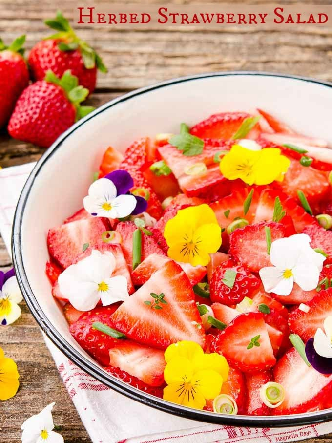 Herbed Strawberry Salad is a delightful mix of fresh strawberries, herbs, green onion, and herb dressing. It's a bowl of summer goodness.