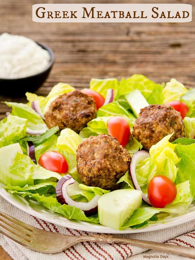 Greek Meatball Salad has beef and lamb meatballs, cucumber, onion, and tomato on romaine lettuce and dressed with tzatziki sauce.
