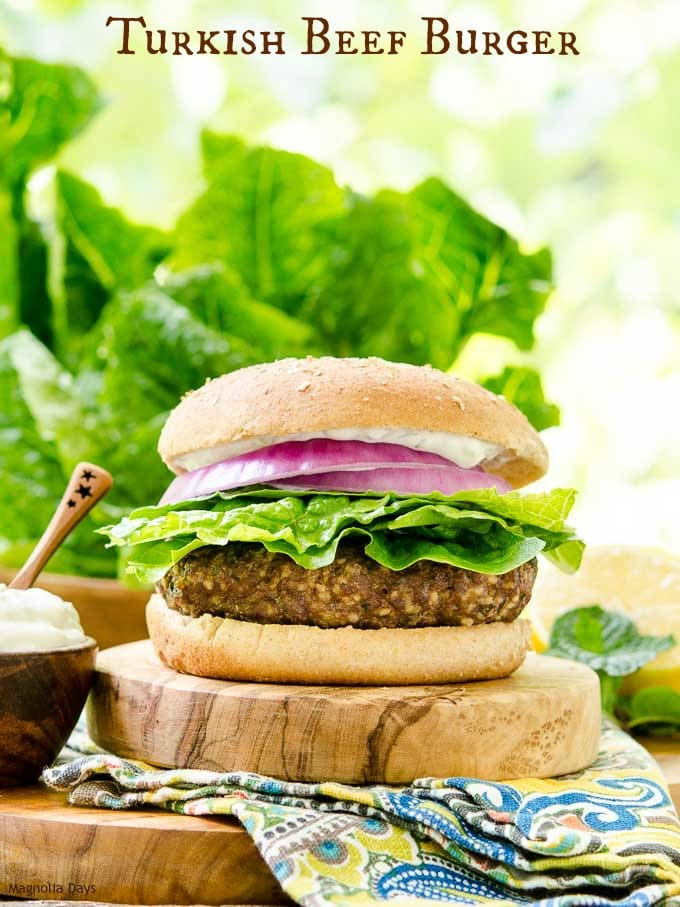 Turkish Beef Burger is made with lean ground beef, couscous, mint, garlic, and lemon. It's deliciously topped with onion, lettuce, and creamy yogurt sauce.