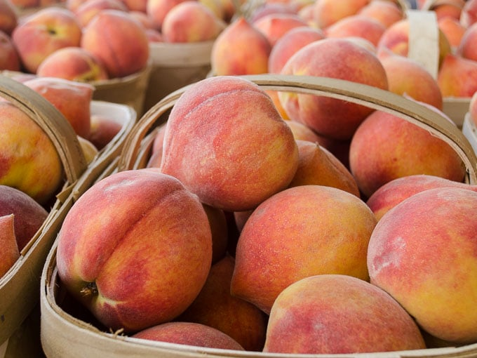 Fresh Peaches in Baskets
