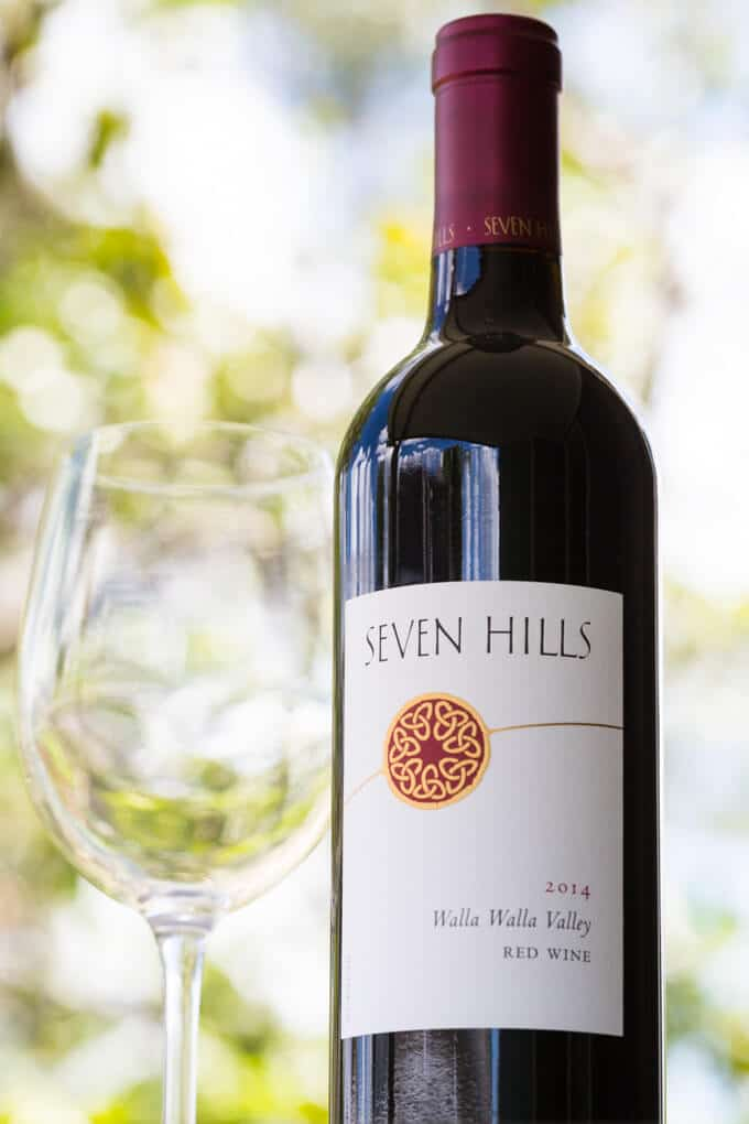 Seven Hills Wine Walla Walla Valley Red wine bottle label with red wine glass outdoors