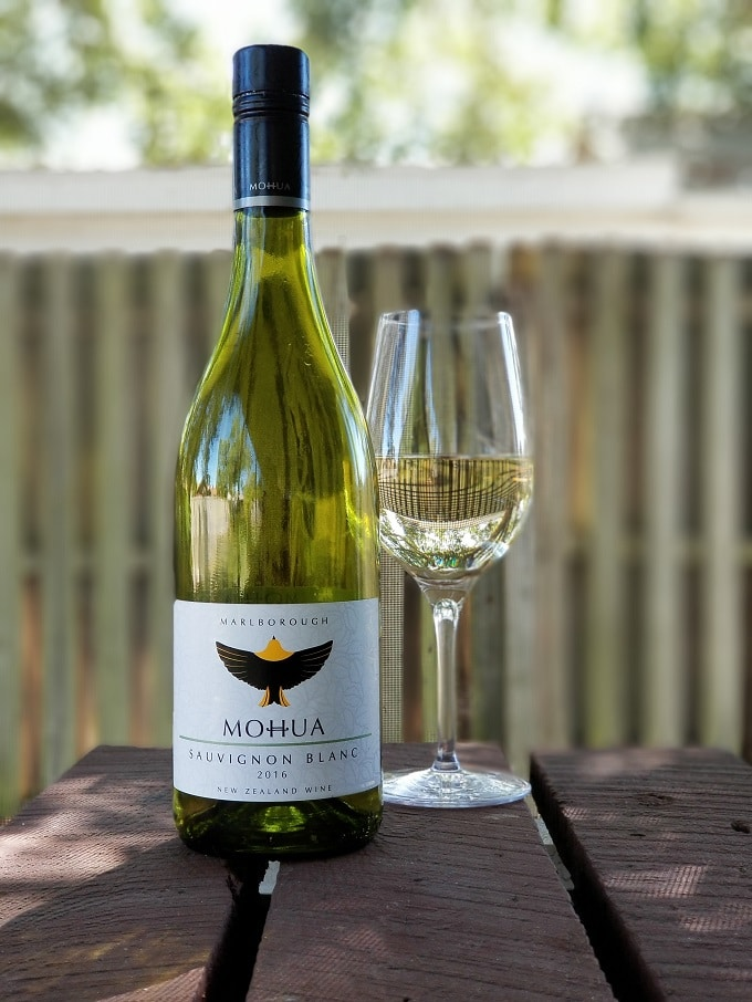 Mohua Sauvignon Blanc 2016 bottle and wine glass outdoors