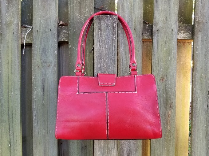 Patricia Nash Rienzo Satchel Back view hanging on a fence