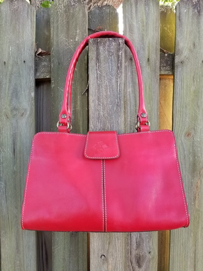 Patricia Nash Rienzo Satchel Poppy Red on a fence