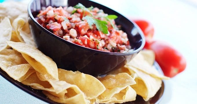 Pico de gallo salsa in a bowl with tortilla chips