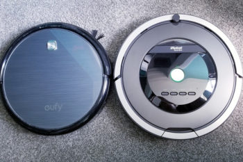 Eufy Robovac 11 and iRobot Roomba 801 on grey carpet