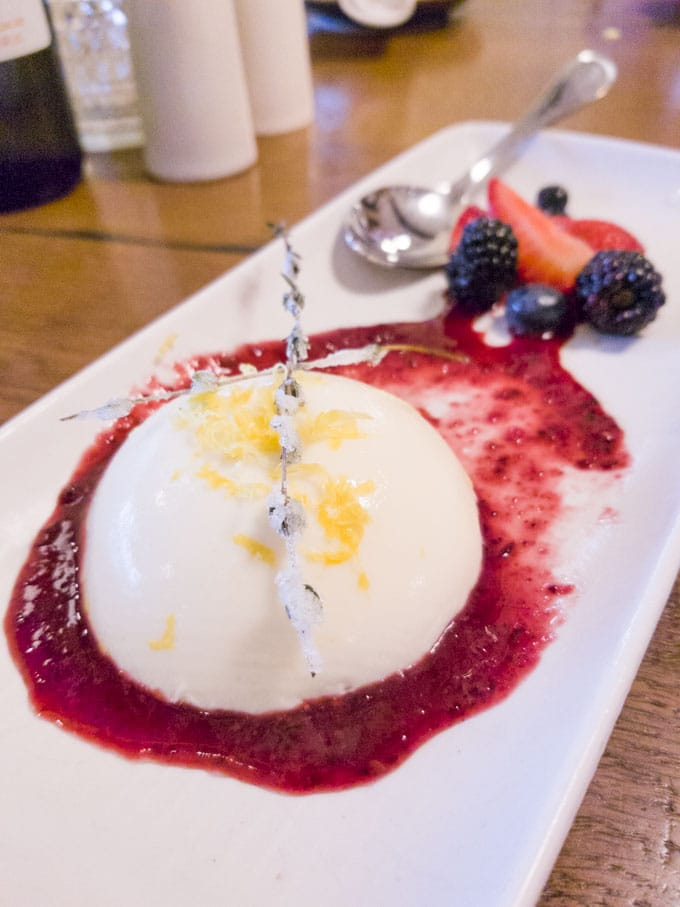 Lemon panna cotta with blackberry sauce and candied thyme