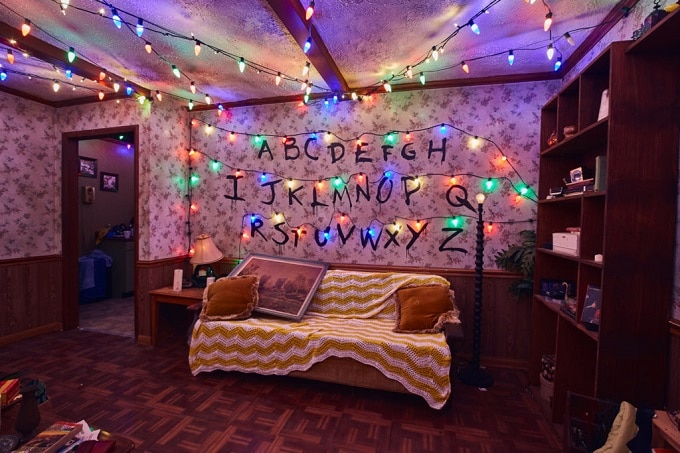 Scary Stranger Things haunted house living room with Christmas lights