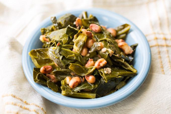 Hoppin John collard greens and black eyed peas in a blue dish