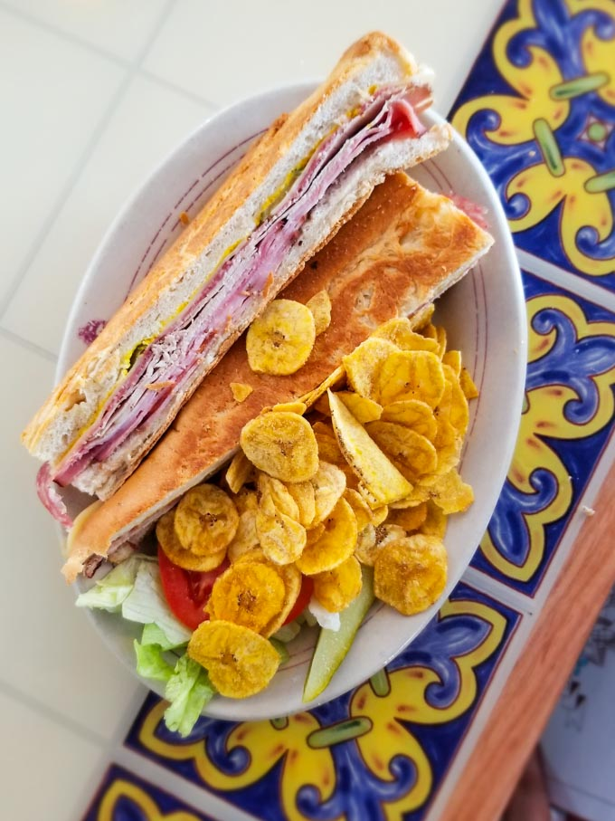 Classic cuban sandwich and plantain chips at Columbia Cafe