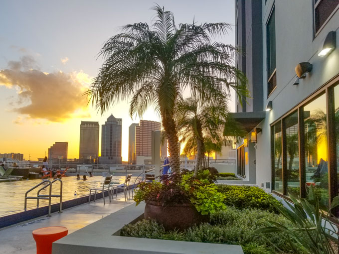 View of Tampa downtown sunset skyline from rooftop hotel pool at Home2 Suites