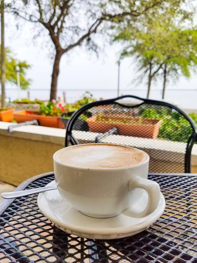 Cappuccino at Caffe di Riverwalk in Sanford with Lake Monroe in background