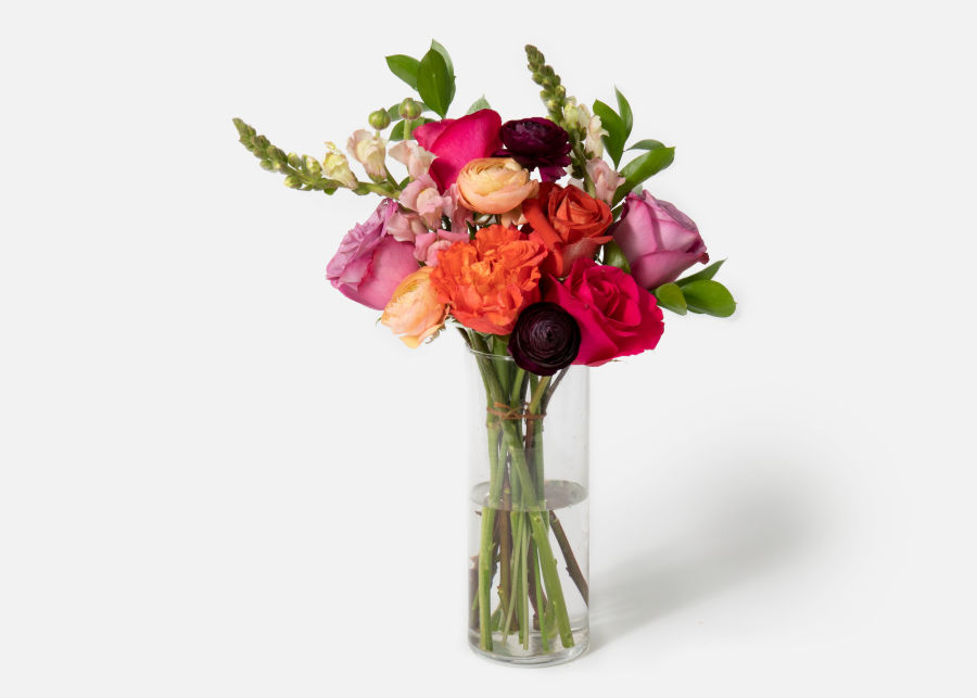 Carnival UrbanStems bouquet in a clear glass vase as pictured on UrbanStems website