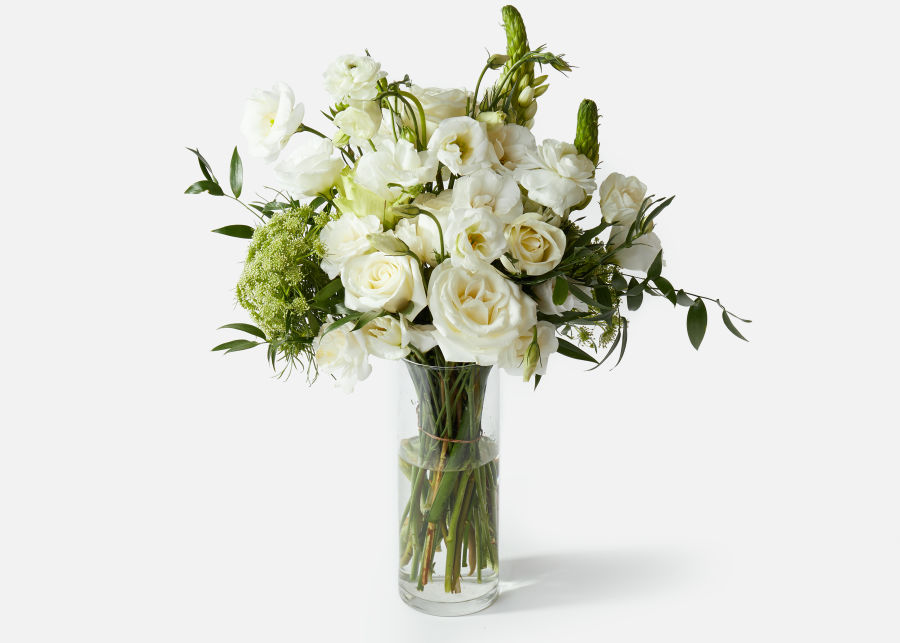 The Postponement white and green bouquet from UrbanStems